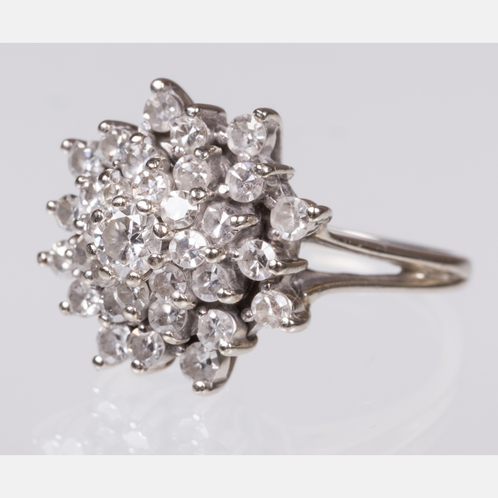 A 14kt. White Gold and Diamond Ring-