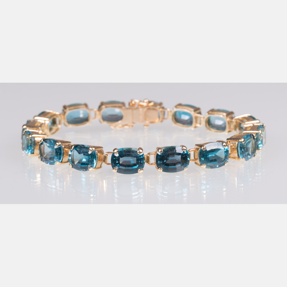 A 14kt. Yellow Gold and Blue Topaz Bracelet-