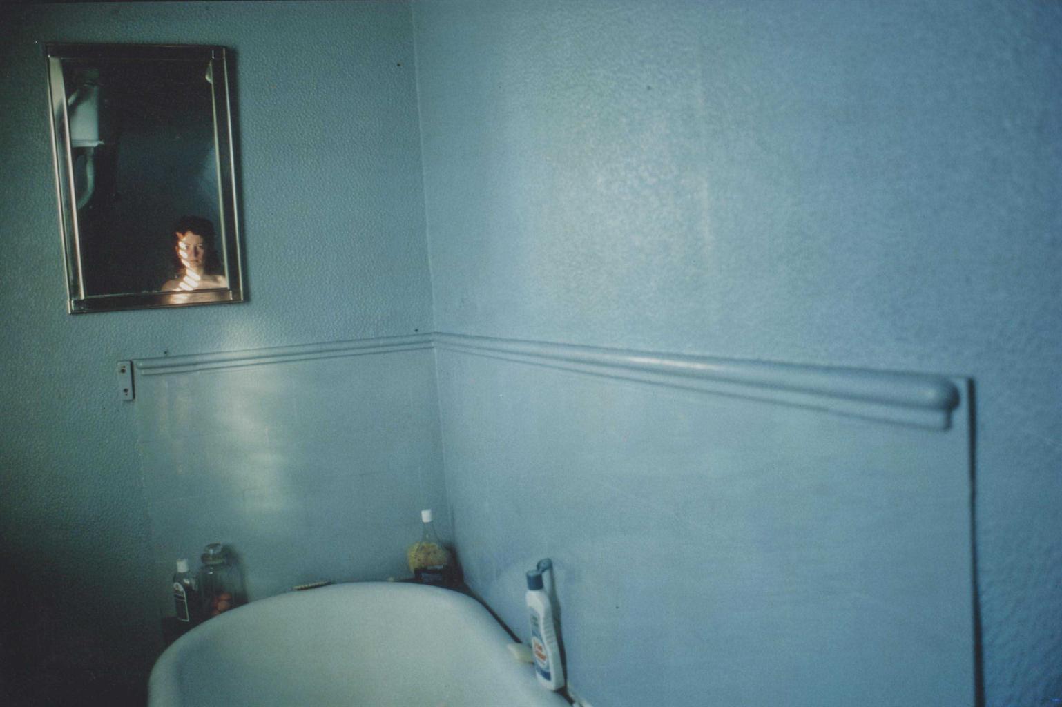 Nan Goldin-Self-portrait in blue bathroom, London-1980