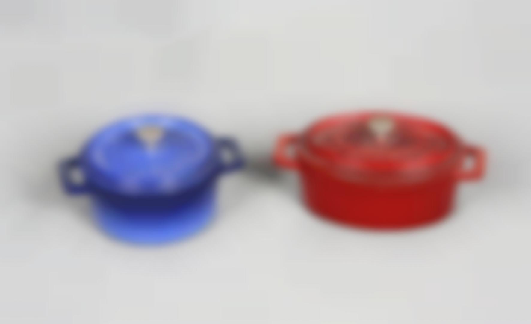 A Pair Of Dutch Ovens-