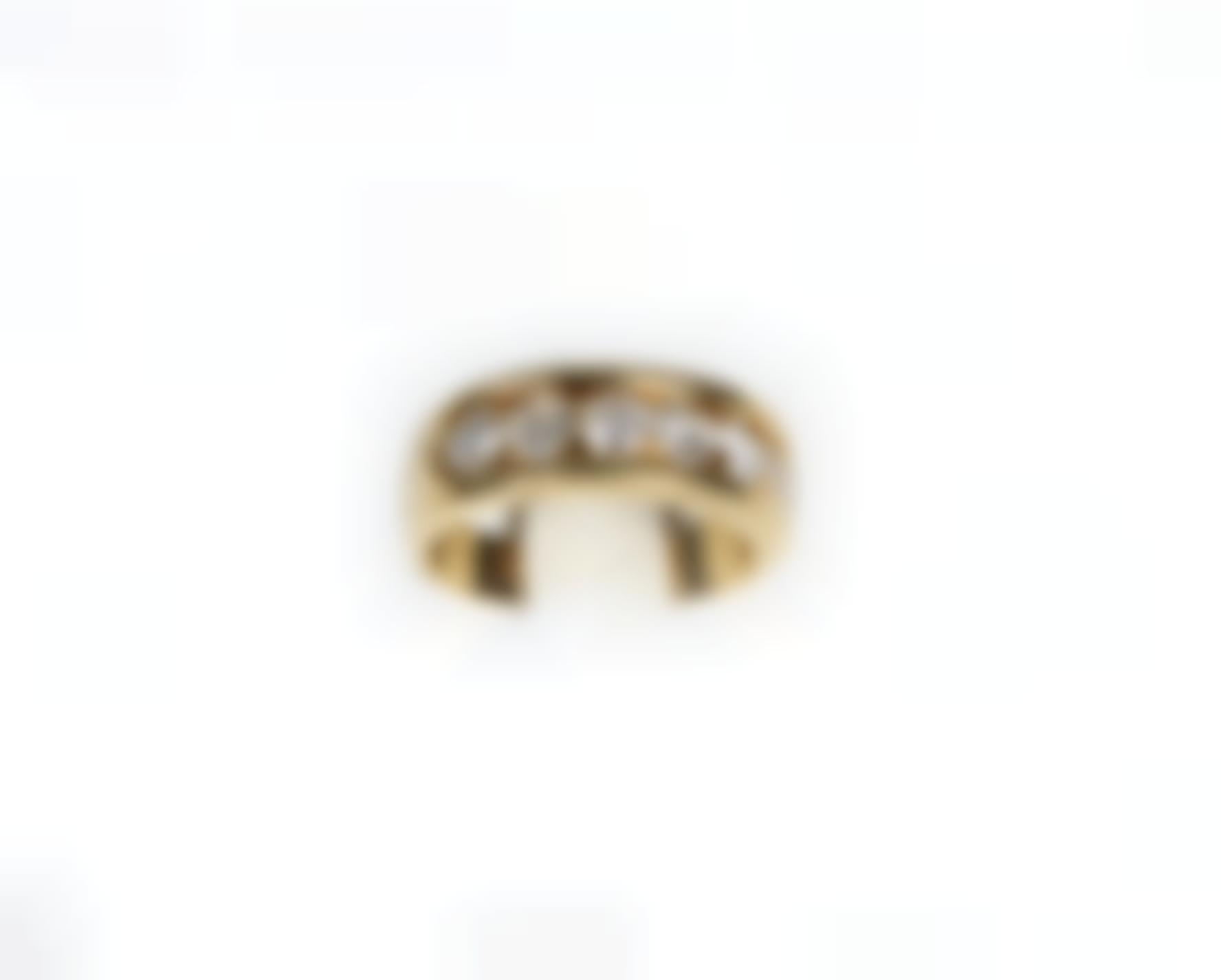 A Gold And Diamond Ring-