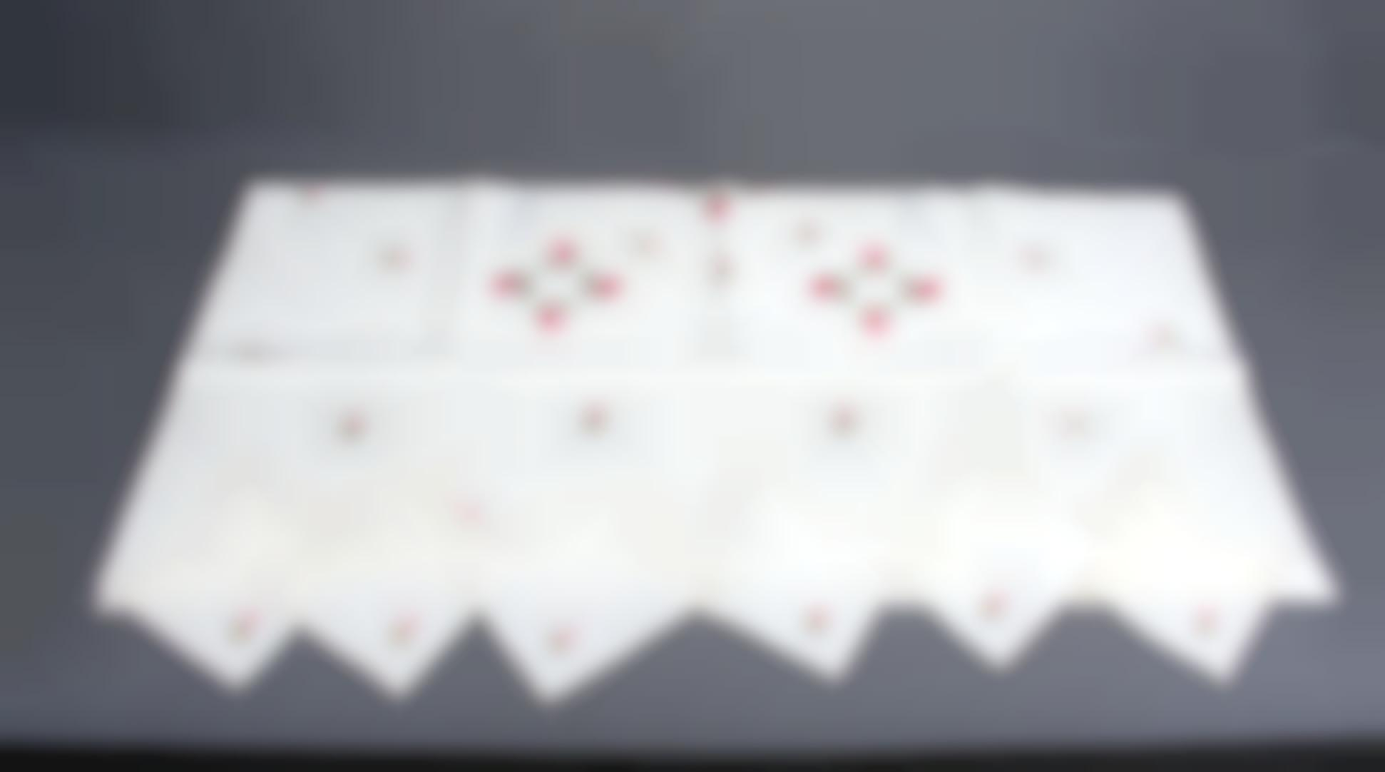A Tablecloth And Napkin Set-