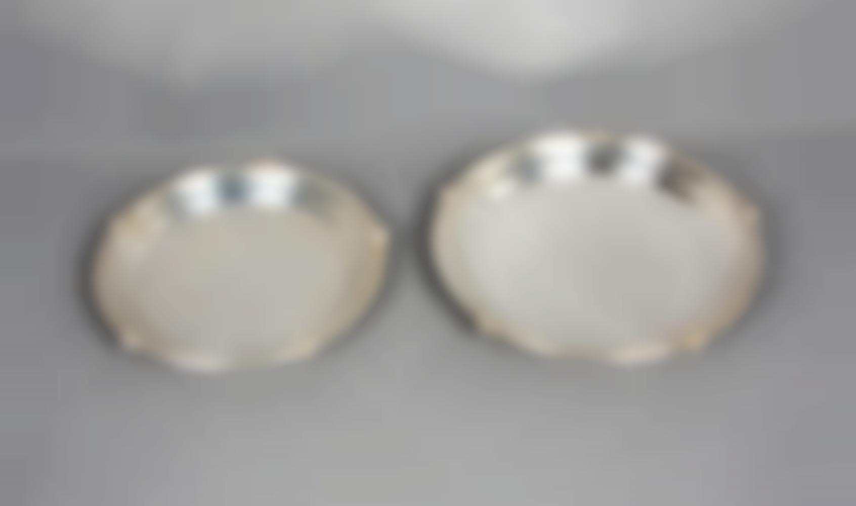A Pair Of Nickel-Silver Dishes-