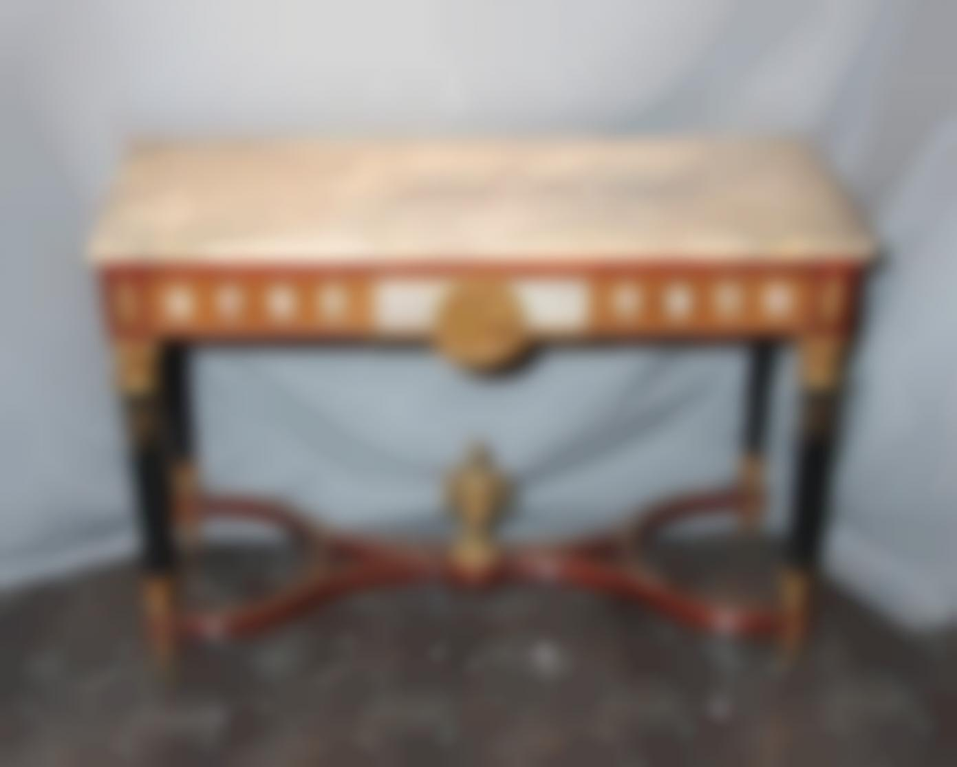 A Wood And Marble Console Table-