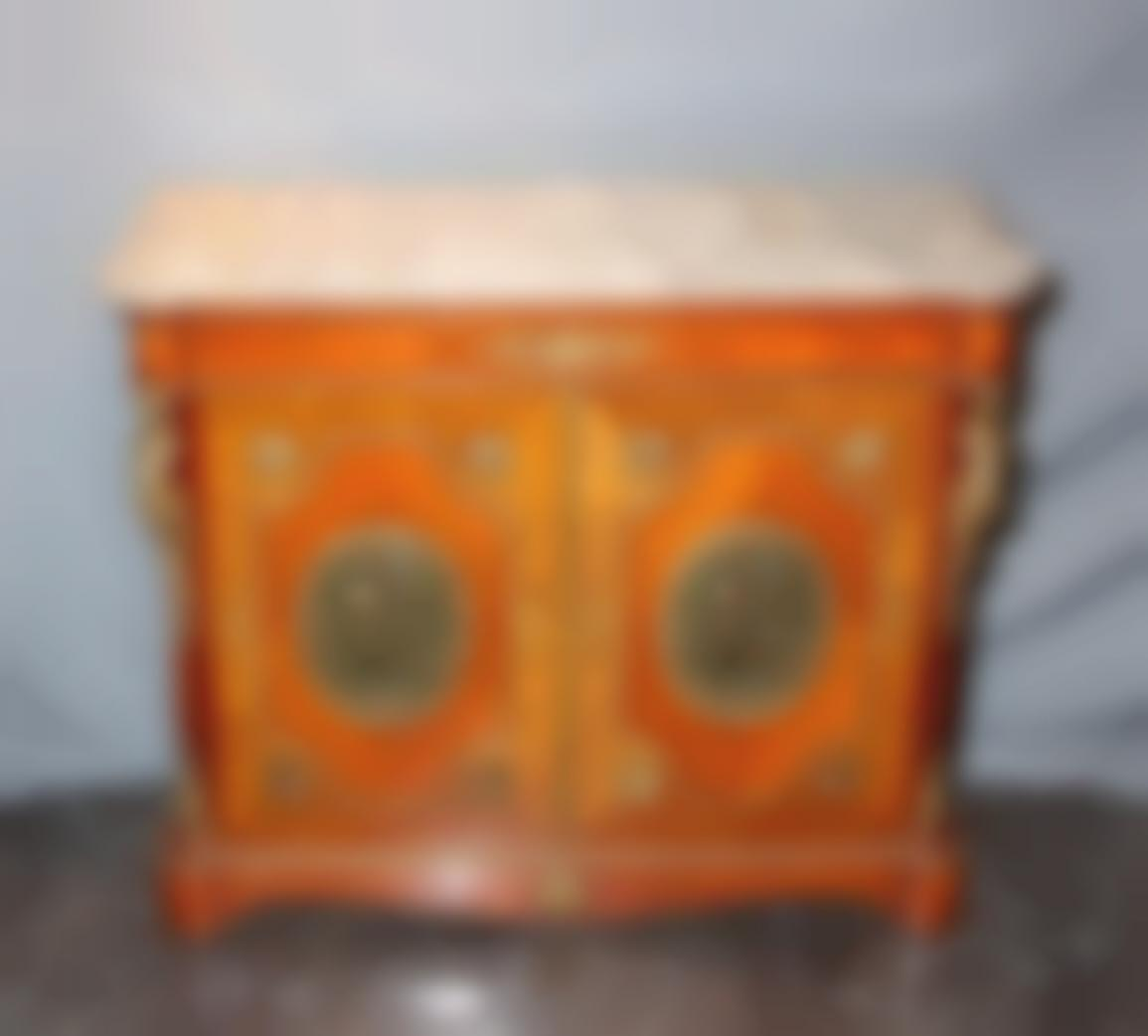A Wood And Gilt Bronze Cabinet-