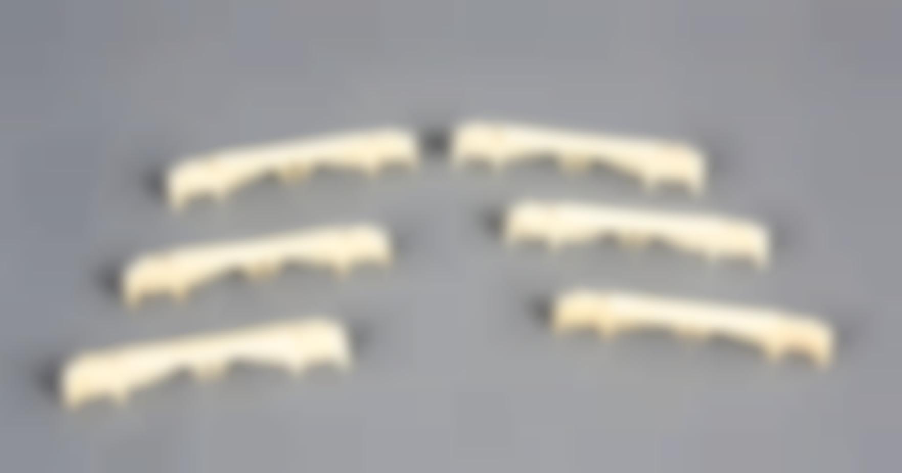 A Set Of Six Carved Ivory Knife Rests-
