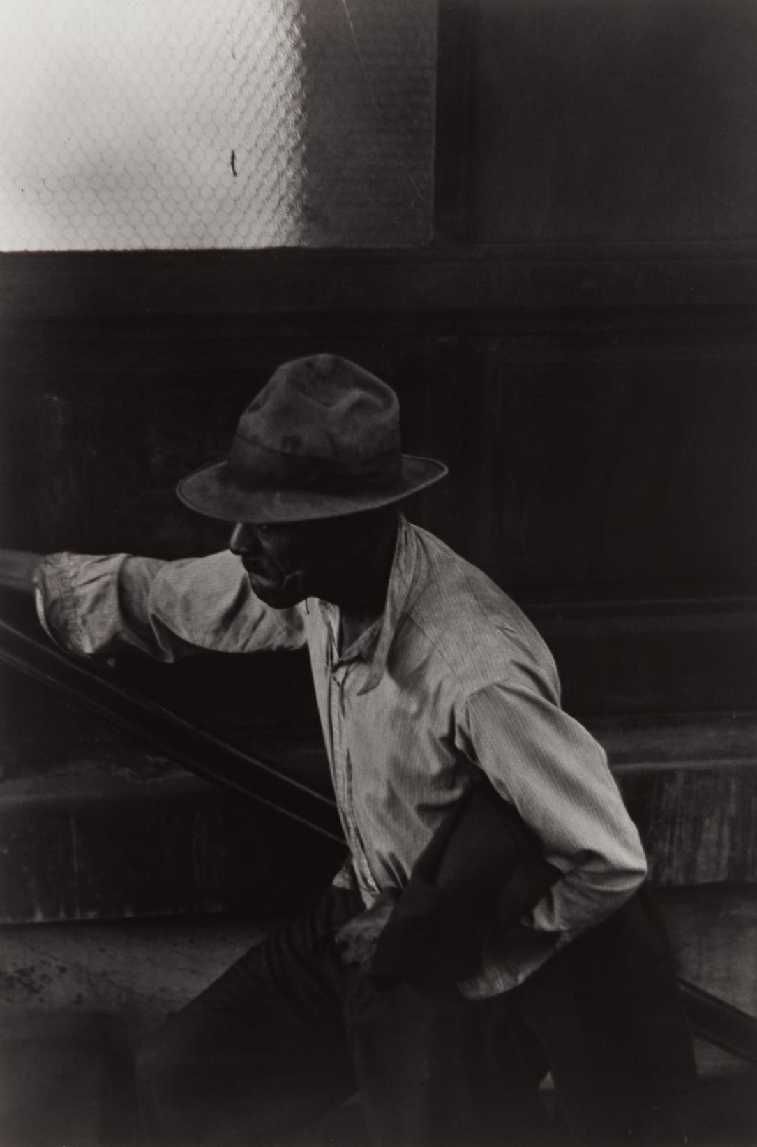 Roy DeCarava-Man Coming Up Subway Stairs-1952