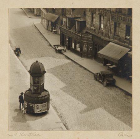 Andre Kertesz-Paris (man at a pissoir, Latin Quarter)-1927