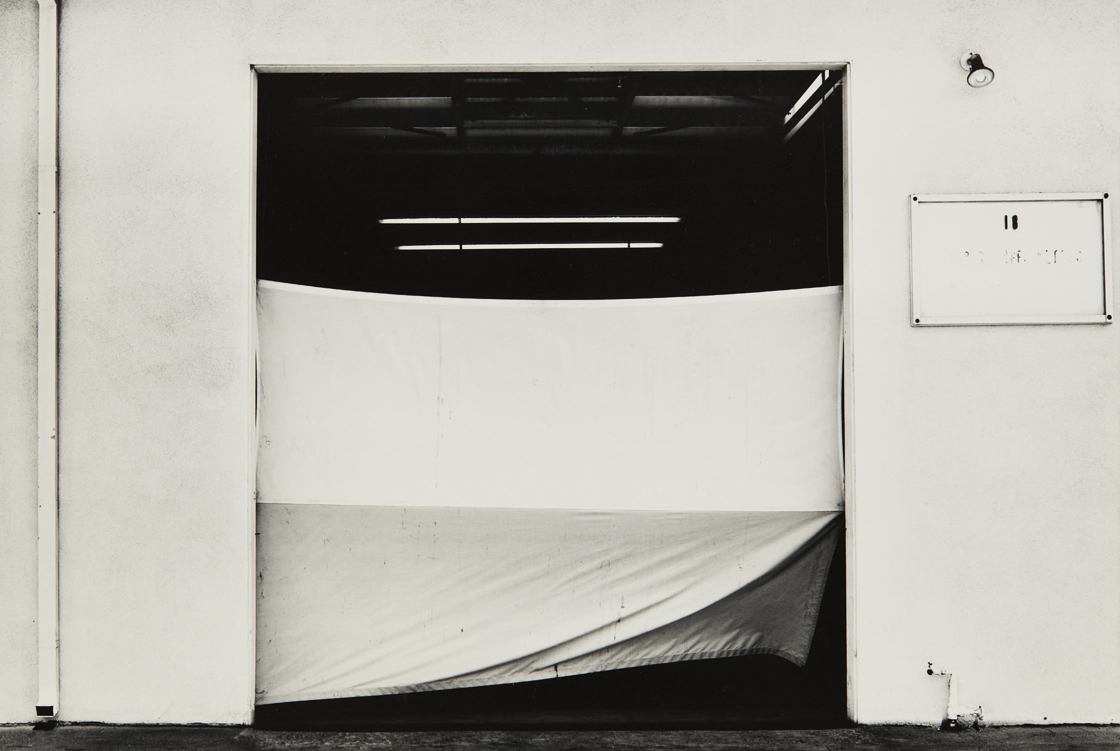 Lewis Baltz-West Wall, Space 18, 817 West 17th Street, Costa Mesa, from The new Industrial Parks near Irvine, California-1974