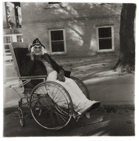 Diane Arbus-Masked Woman in a Wheel Chair, PA.-1970