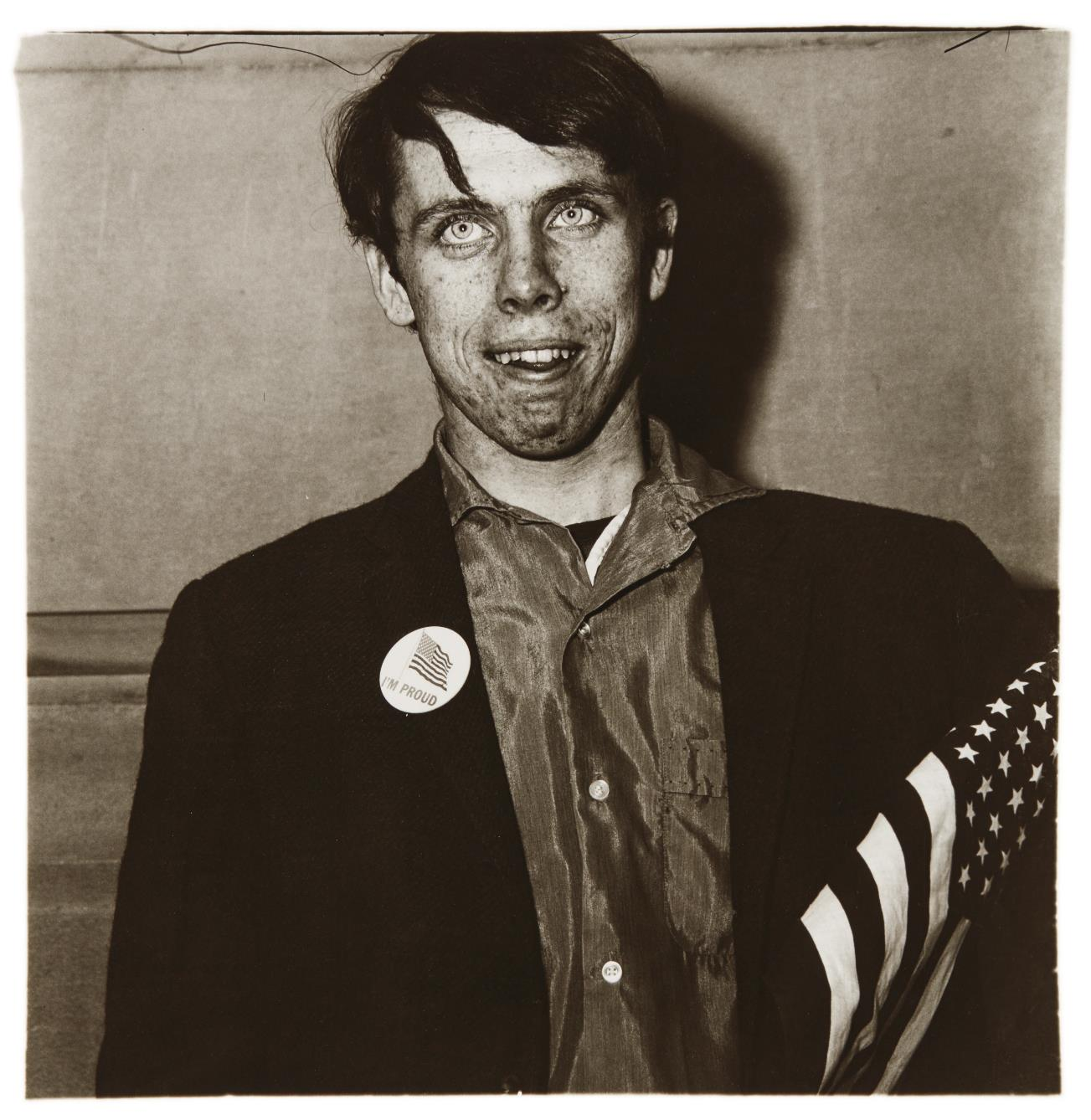 Diane Arbus-Patriotic Young Man with a Flag, N.Y.C.-1967