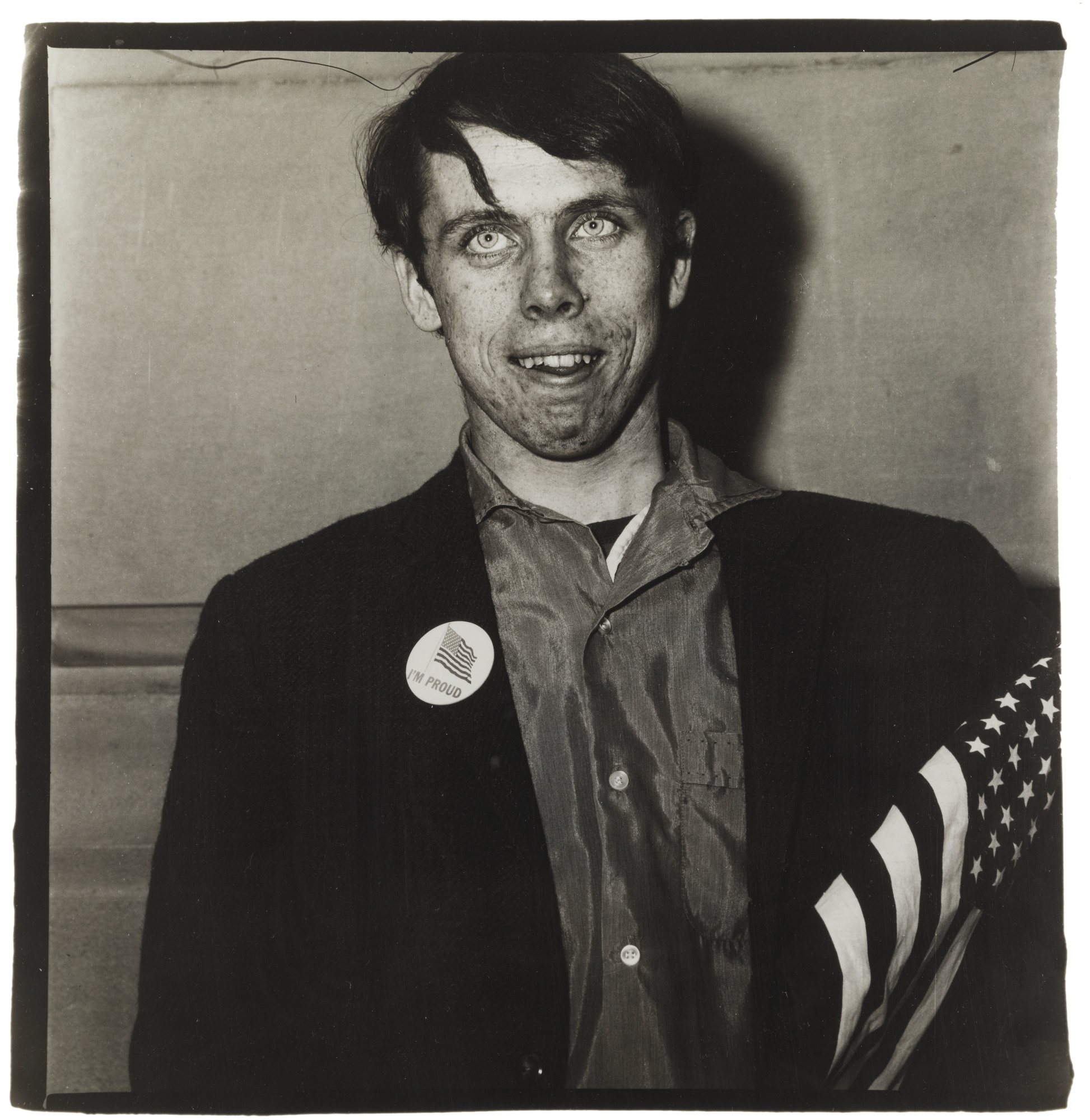 Diane Arbus-Young Boy With A Button Flag In A Pro-War Parade N. Y. C. (Patriotic Young Man)-1967