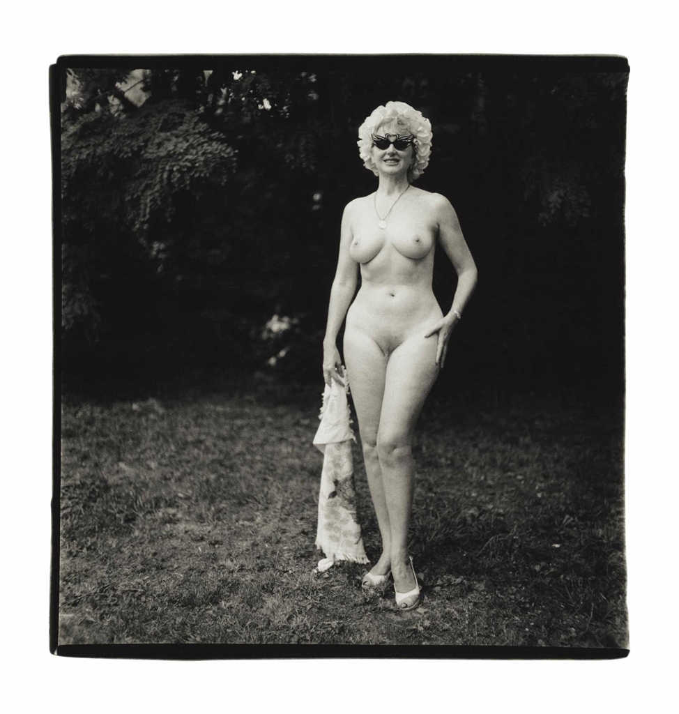 Diane Arbus-Nudist Lady With Swan Sunglasses, Pa.-1965