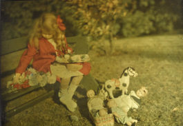Alfred Stieglitz-Georgia Engelhard In A Red Coat, With Flowers And Toys-1915