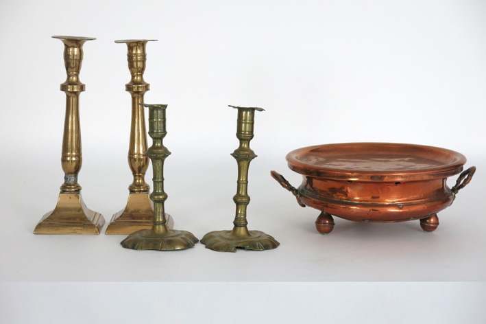 Two pairs of antique candlesticks in brass-