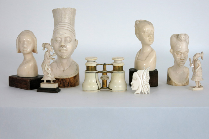Several African sculptures in ivory and an opera binocular-