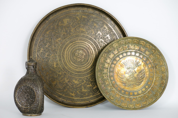 Three Persian items in bronze: a triangular flask, a dish (peacock) and a 19th Cent. dish (animals)-