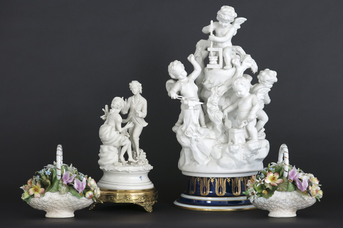 Several items in porcelain or biscuit with a quite big neoclassical group with cupids-
