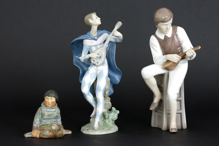 Two figures in marked 'Royal Kopenhagen' porcelain and a small 'Lladro' figure in marked porcelain-