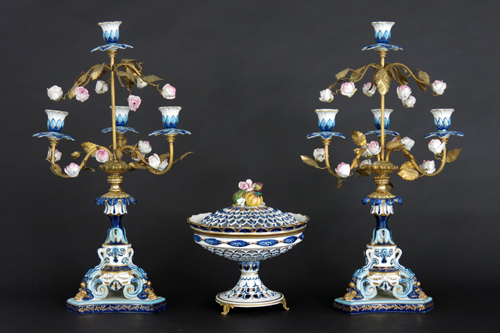 Pair of candelabra and a lidded bowl in marked porcelain and bronze-