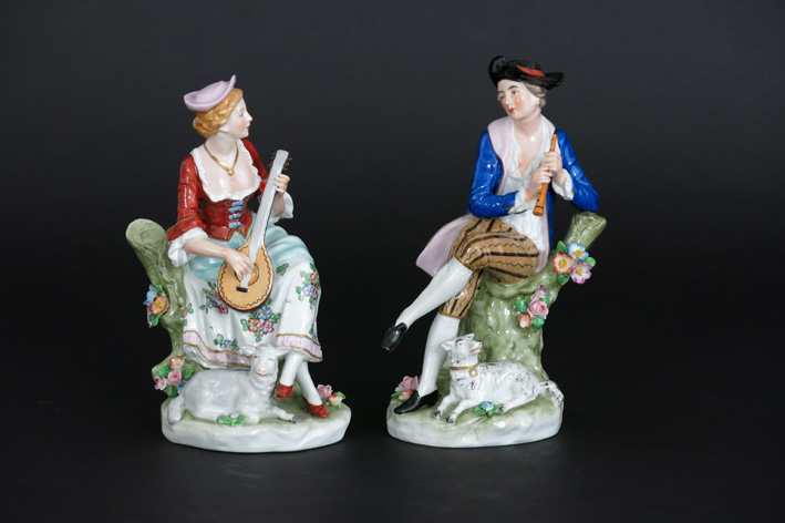 Pair of antique figures in porcelain-