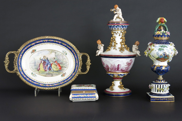 Several items in marked porcelain with an oval dish with bronze mounting-
