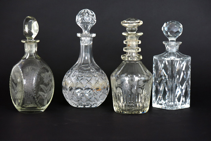 4 decanters/claret jugs in crystal-