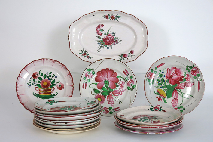 Several antique plates and an oval dish in French earthenware-