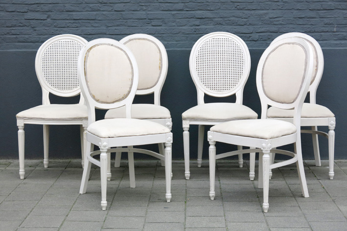 A set of four and a pair of Louis XVI-style chairs in painted wood-