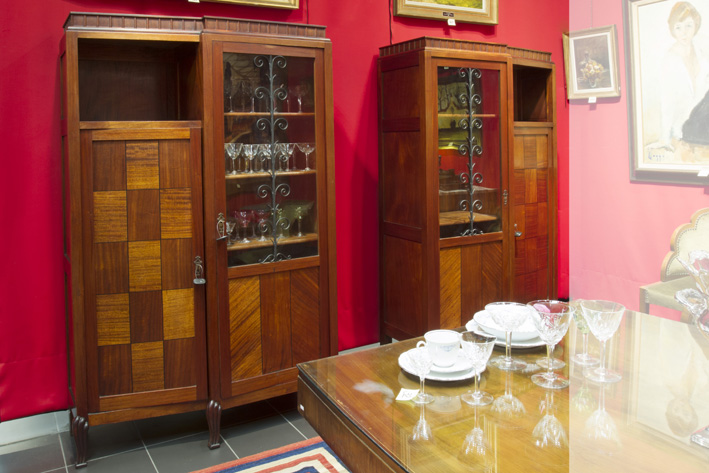 Pair of Belgian Art Deco-bookcases (identical but in reverse) in mahogany and wrought iron-