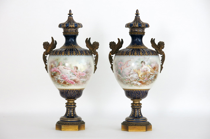 Pair of late 19th Cent. French lidded vases in marked Sèvres porcelain with E. Poitevin decoration and with bronze mountings-