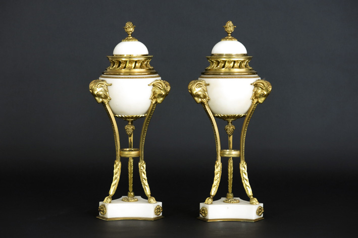 Pair of antique neoclassical lidded cassoletvases (incense burners) in white marble and guilded bronze-