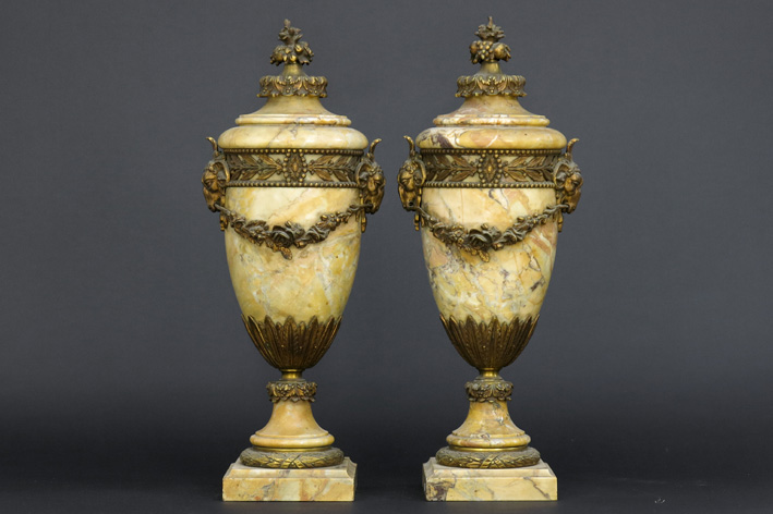 Antique pair of neoclassical lidded urns in marble and guilded bronze-