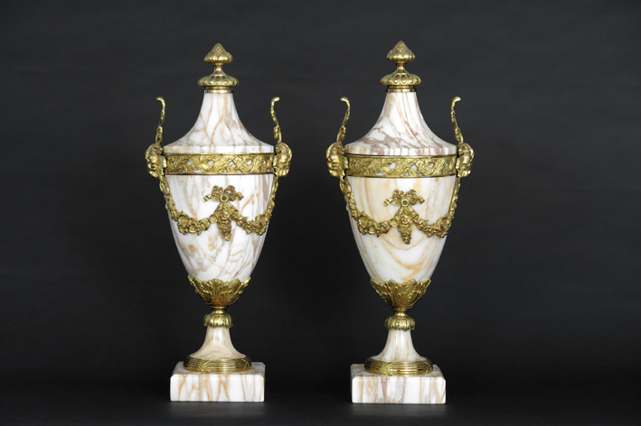 Pair of quite big neoclassical cassoletvases in marble and guilded bronze-