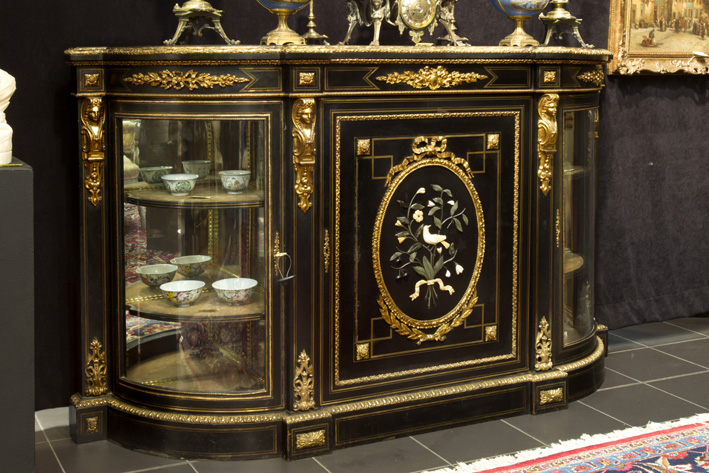 Superb 19th Cent. French display sideboard in 'Boulle' with ebony, brass inlay and mountings in guilded bronze and with an oval medaillon with incrusted semi-precious stones-1870