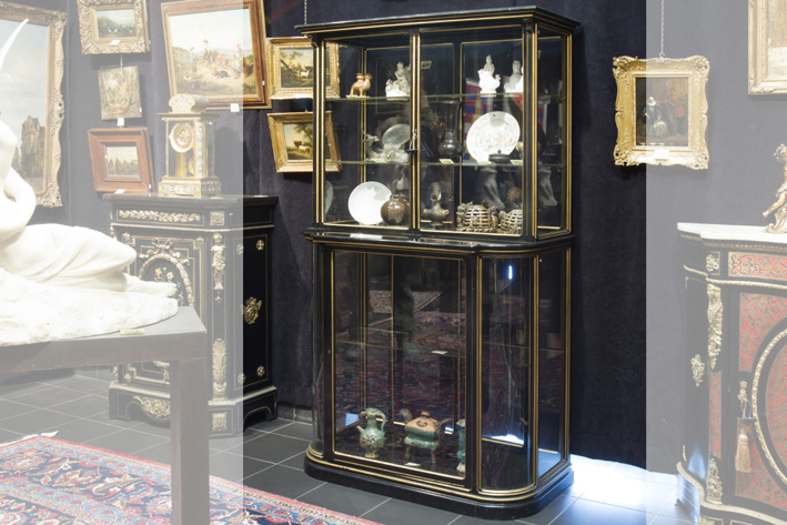 Quite special 19th Cent. shop's cabinet in glass and ebonised and guilded mahogany-