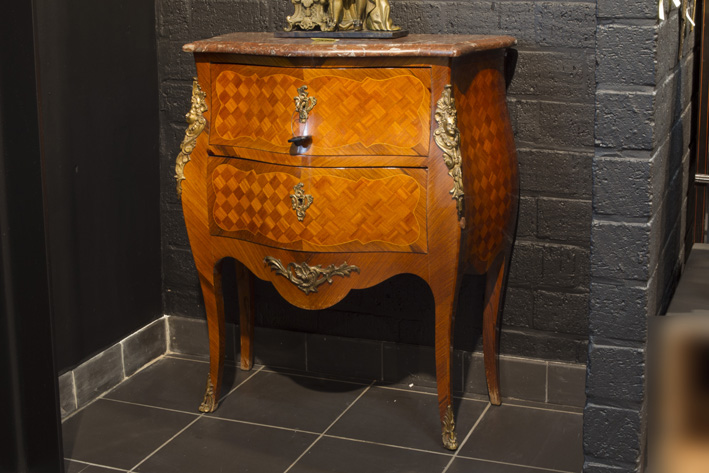 Small antique French chest of drawers in marquetry (with rose-wood on oak) with mountings in bronze and its marble top-