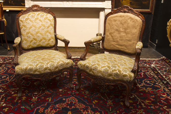 Antique Louis XV-set in carved oak with a table and two armchairs-