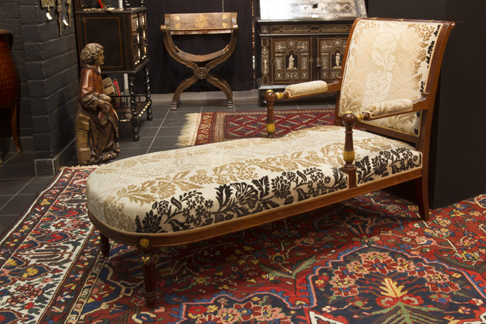 Antique neoclassical daybed in mahogany with sculpted, partially guilded ornamentation-