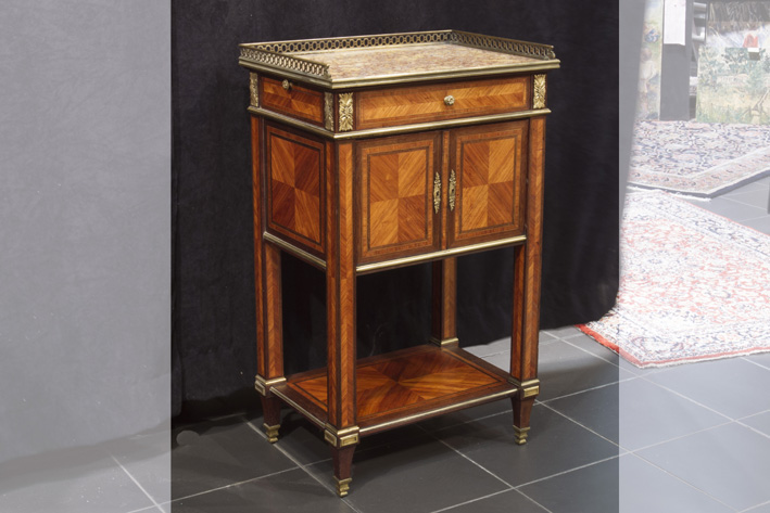 19th Cent. French neoclassical cabinet in rose-wood with mountings in guilded bronze and its marble top with gallery-