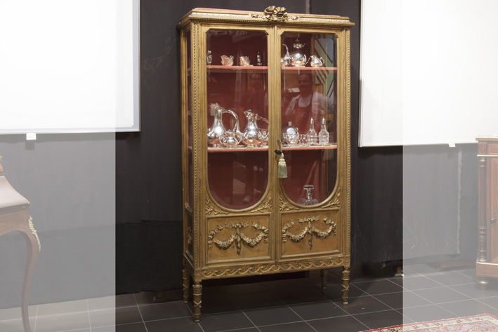 Antique Louis XVI two doors display cabinet in sculpted and guilded wood-