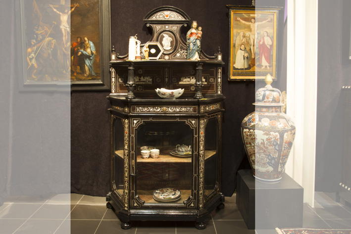 1st half of the 19th Cent. probably Italian Renaissance style displaycabinet in ebony with inlay of ivory and stone cabochons-