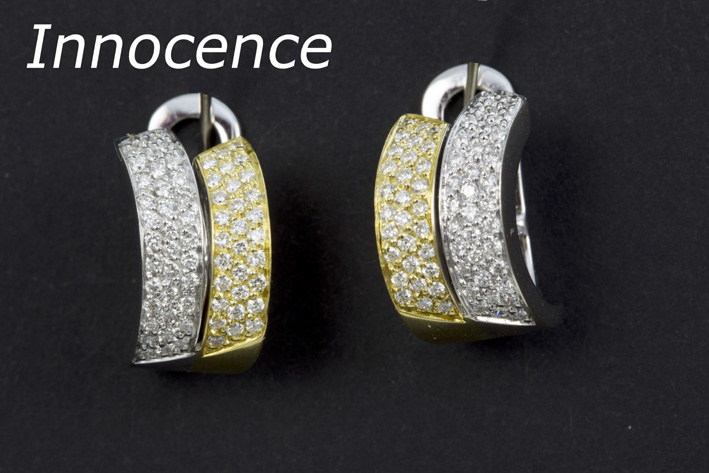 Pair of 'Innocence' earrings in yellow and white gold (18 carat) with ca 0,70 carat of high quality brilliant-