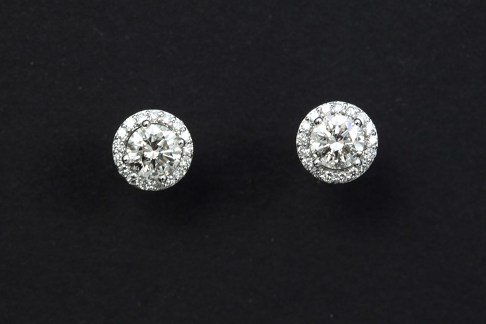 Pair of cute earrings in white gold (18 carat) each with a brilliant of ca half a carat and small very high quality brilliants-