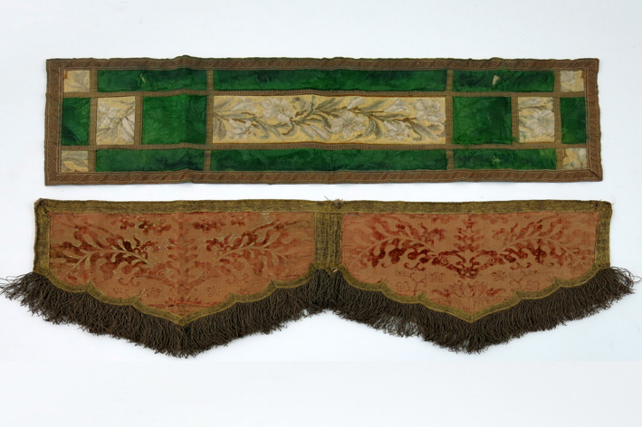 An old table runner in gold brocade and an antique embroidered cope with brocade-