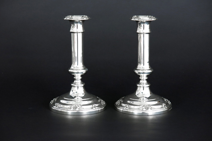 Antique pair of Victorian candlesticks in marked silver-