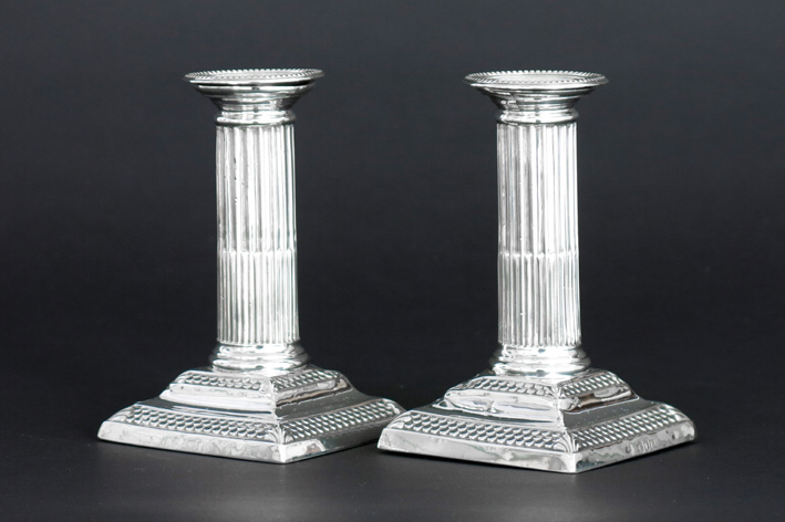 Pair of small neoclassical candlesticks in marked silver-