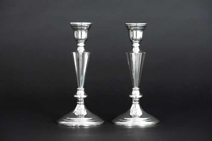 Pair of candlesticks in marked silver-