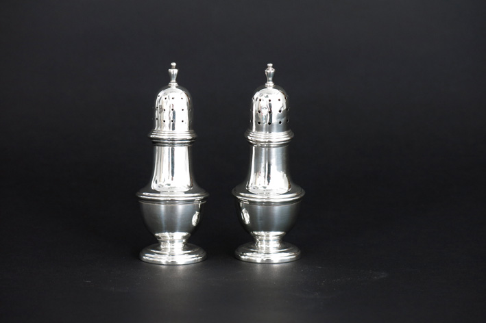 Pair of salts/salt cellars in marked silver-