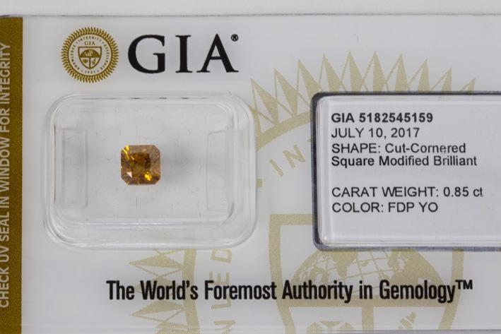 Fancy color brilliant of 0,85 carat with natural fancy orange color-